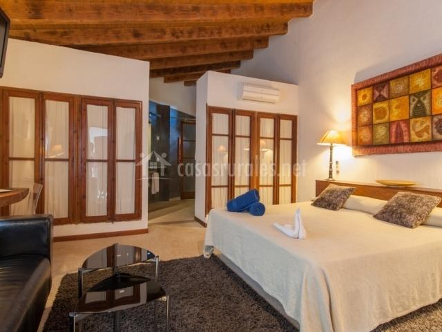 Dormitorio suite especial con cama doble