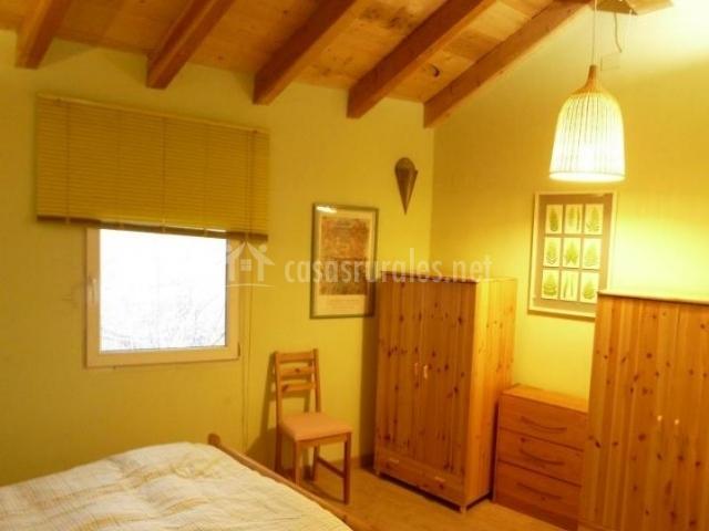 Dormitorio doble en madera y abuhardillado
