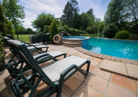 Large swimming pool with garden