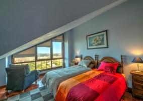 Dormitorio doble con cristalera
