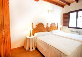 Cruz dormitorio con camas