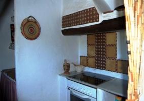 Cocina con horno y placa