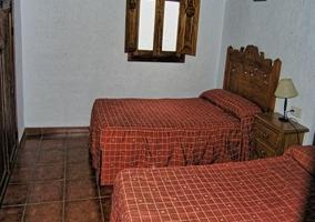 Dormitorio doble con dos camas