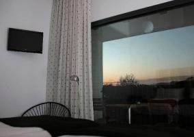 Dormitorio doble superior con terraza