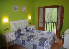 Dormitorio de matrimonio en verde