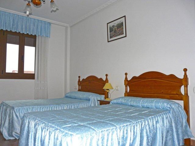 Dormitorio doble de apartamento cuádruple