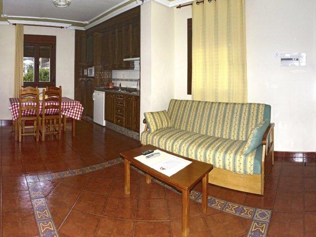 Cocina y salón de uno de los apartamentos cuádruples