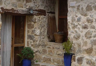 Entrance door with stone facade