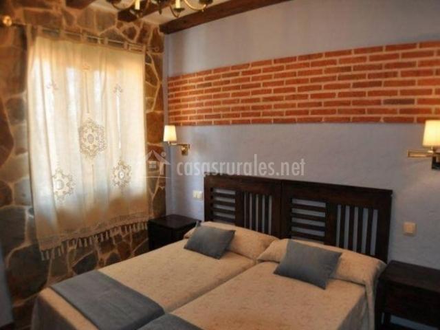 Dormitorio doble con detalles azules