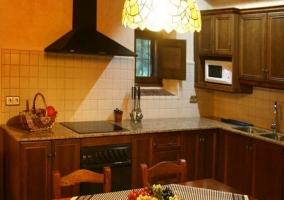 Salón comedor y cocina a doble altura