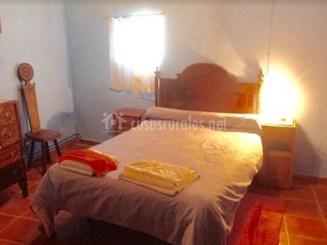 Dormitorio de matrimonio y alfombras