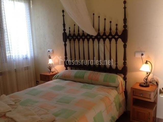 Dormitorio de matrimonio de tonos pastel