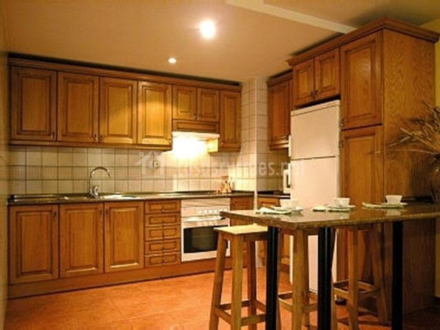 Garcisancho en rascafria madrid for Cocina unida a salon