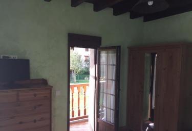 Dormitorio con salida en el exterior