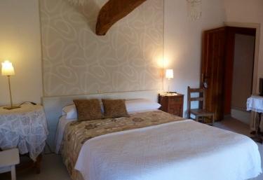 Dormitorio doble con viga