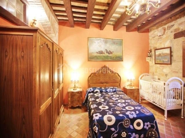 Dormitorio individual con cuna