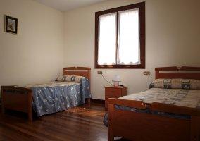 Dormitorio muy conjuntado para dos personas