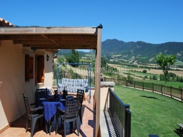 Terraza privada con muebles de exterior