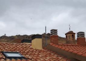 Vistas a los tejados y chimeneas