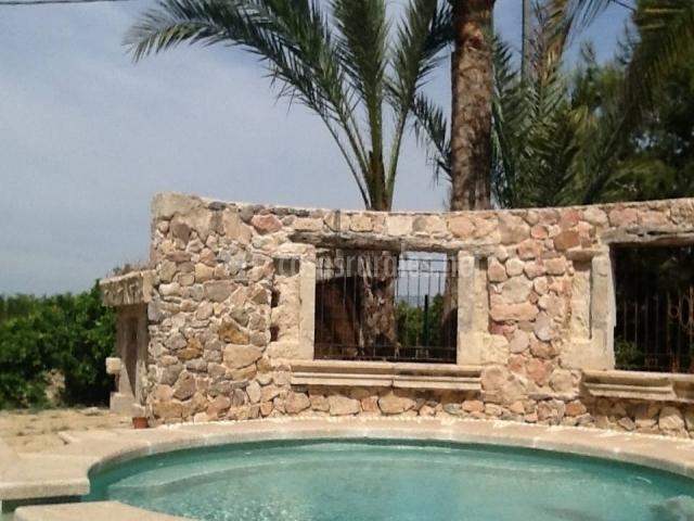 Casa lim n la carrasca en catral alicante - Como hacer muros de piedra ...