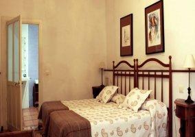 Dormitorio doble el Hogar y entrada al aseo