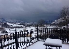 Terraza y vistas nevadas