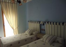 Dormitorio doble azul y blanco