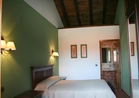 Dormitorio en tonos verdes