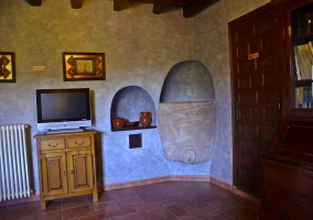 Antigua lavanderia convertida en sala de estar