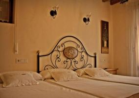 Dormitorio doble con su cama supletoria