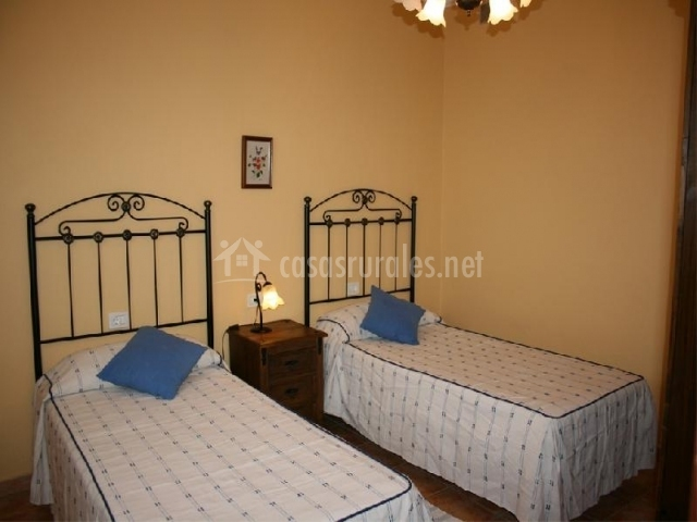 Dormitorio doble con camas individuales