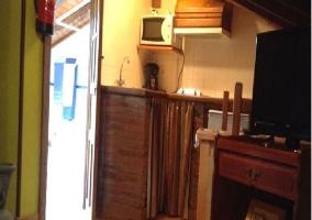 Cocina y entrada de la casa