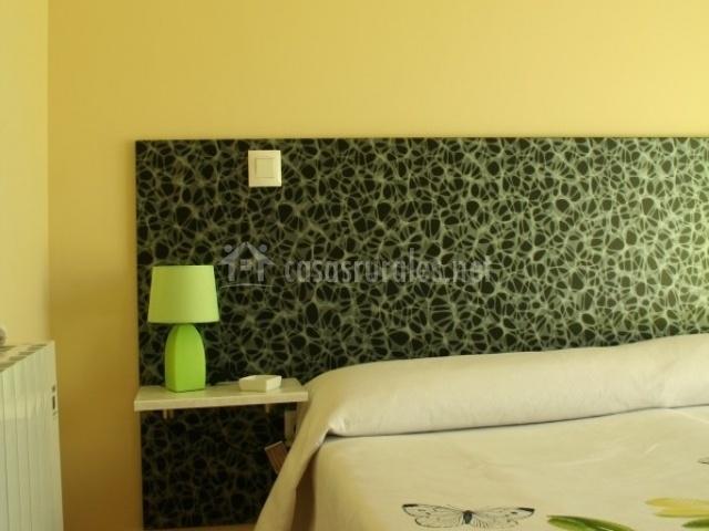 Dormitorio suite con cabecero moderno