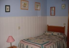 Dormitorio doble con pared dividida