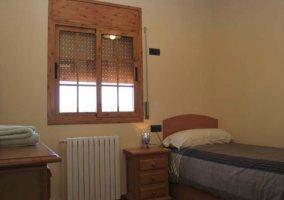 Dormitorio individual con calefacción