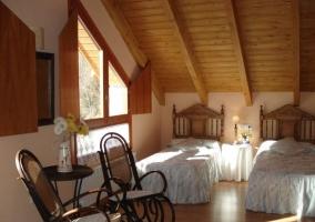 Dormitorio doble con mecedora