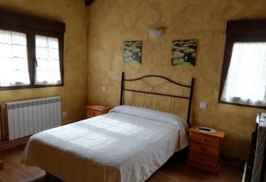 Dormitorio de matrimonio con cabecero