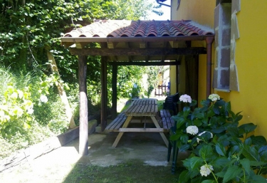 Roofed picnic area in the garden of the houses