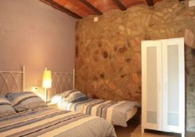 Dormitorio triple cama de matrimonio