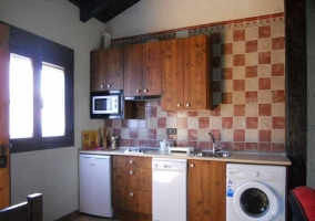 Sala de estar junto a la cocina de la vivienda