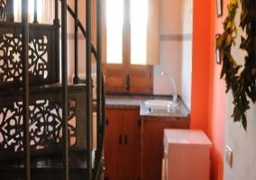 El salón, con su televisión de pared