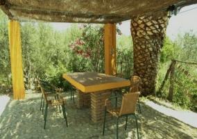 Porche con mobiliario de terraza