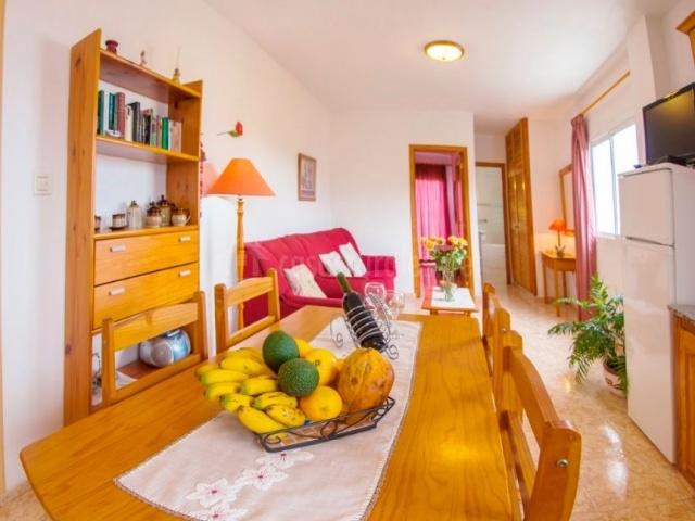 Apartamentos ovio en llanes asturias for Sala de estar y cocina