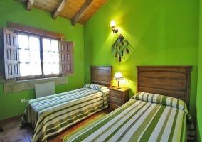 Dormitorio en tono verde