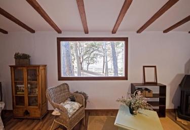 Zonas interiores bajo vigas de madera