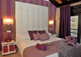 Dormitorio Paraíso con cabecero original