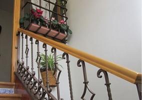 Escaleras con balaustrada de forja
