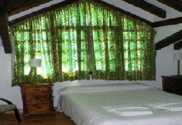 Dormitorio de matrimonio en tonos verdes