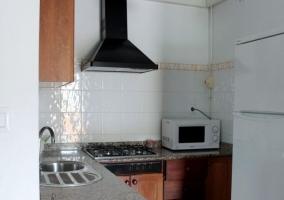 Sala de estar y comedor en madera y con estufa