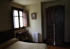 Dormitorio y entrada